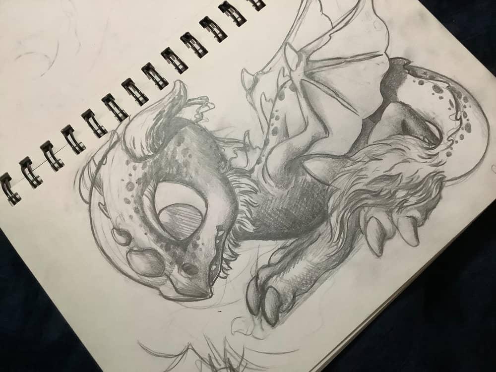 pencil sketch of cute dragon